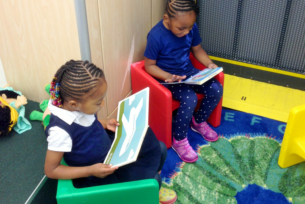young children reading in the Pratt Book Buggy