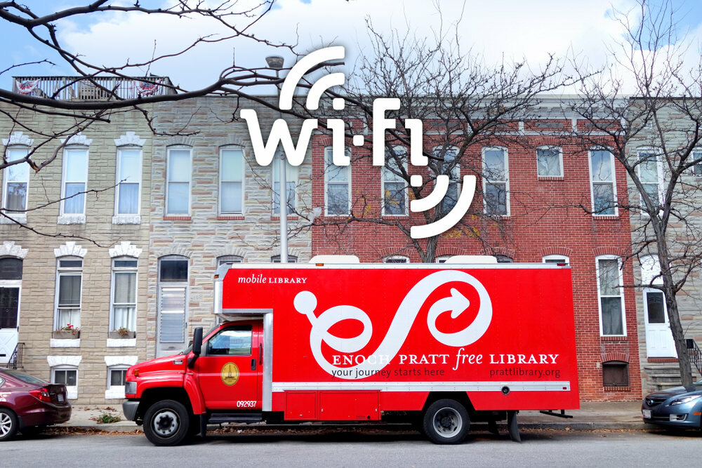 Community Wi Fi - Pratt Bookmobile on a Baltimore street, with Wi-Fi hotpsot logo