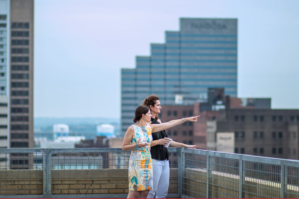 Pratt Insiders overlooking the city at a private rooftop event