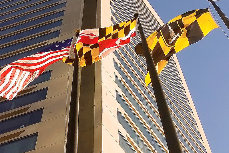 flags of US, Maryland, Baltimore with building