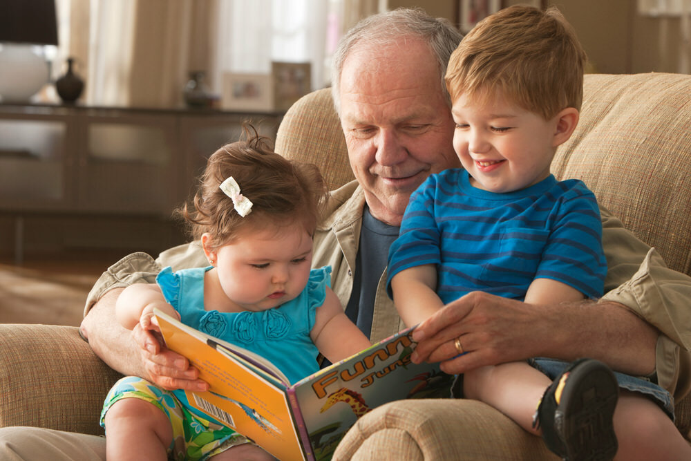 Grandpa reading to young children