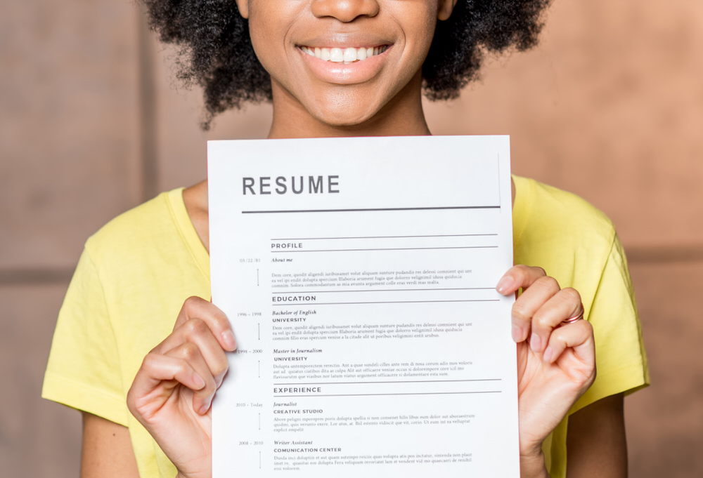 woman holding a completed resume