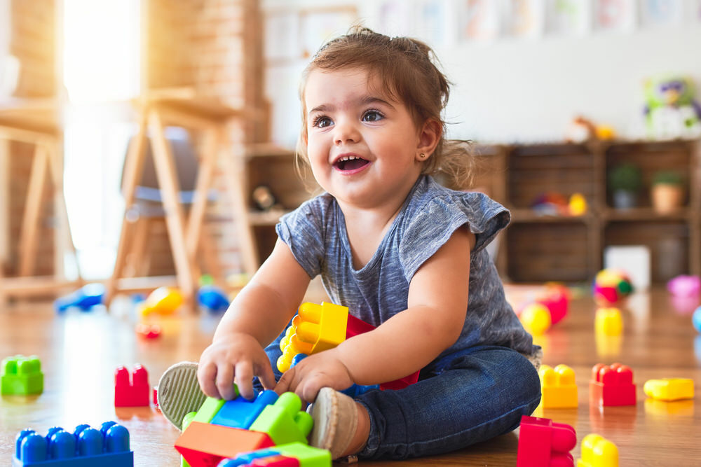 preschool child playing and smiling