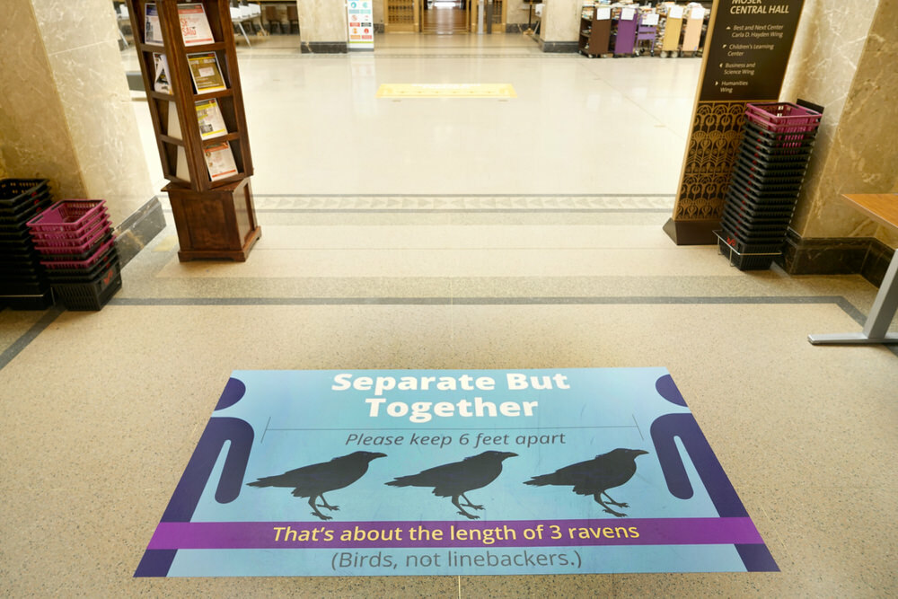 Ravens COVID sign - 6 feet apart, Central Library