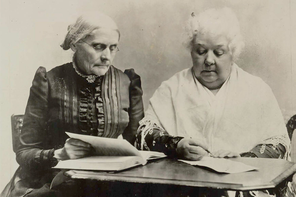 Susan B. Anthony and Elizabeth Cady Stanton at a table. Library of Congress.