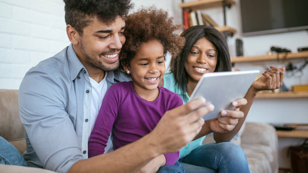 family with a digital tablet at home