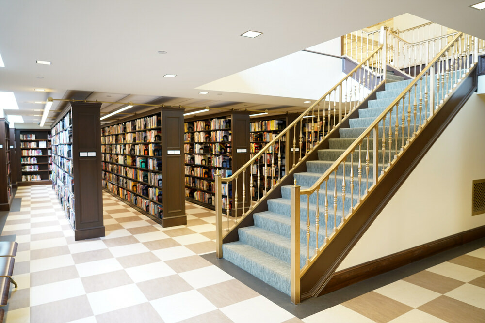 Fiction Department stairs and bookshelves