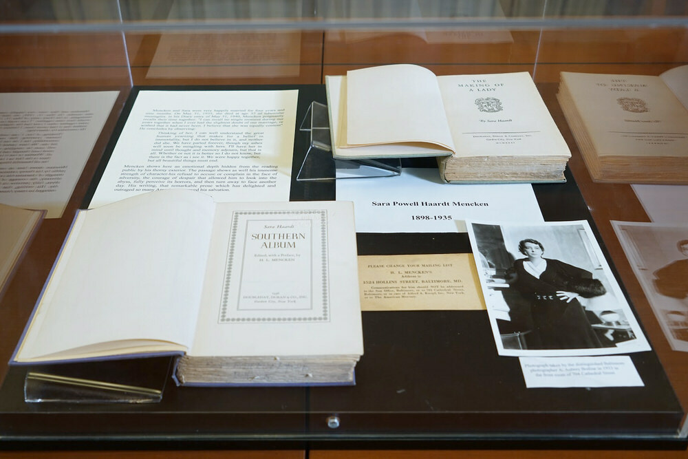 Mencken Room display case with books and a photo of his wife Sara
