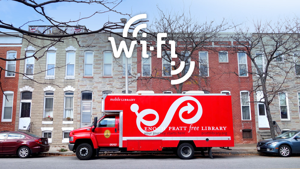 Community Wi-Fi - Bookmobile on a Baltimore street with a hotspot logo