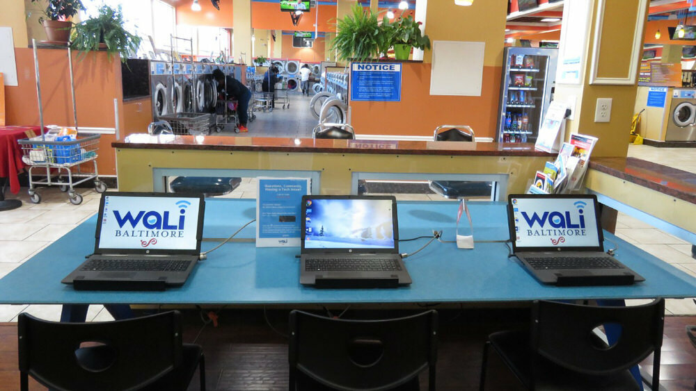 WaLi laptops at a Baltimore laundromat - photo credit Jessica Smith on Medium
